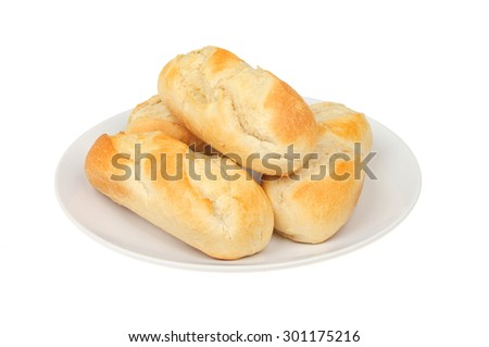 Freshly baked baguettes on a plate isolated against white - stock photo