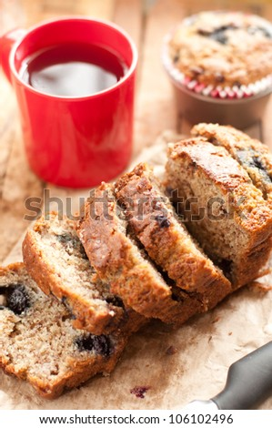Freshly baked banana  and blueberry bread slices with a cup of coffee in vertical format - stock photo