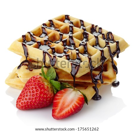 Freshly baked belgium waffles with chocolate sauce and strawberries isolated on white background - stock photo