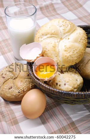 freshly baked bread with eggs and milk - stock photo