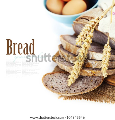 Freshly baked  bread with homespun fabric and eggs on white background  (with easy removable text) - stock photo