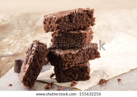 freshly baked brownie and bottle milk - stock photo