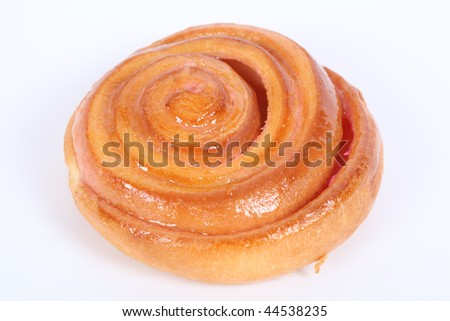 Freshly baked cinnamon rolls on bakery paper on a white background. close-up
