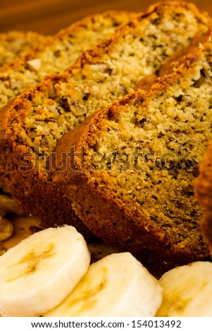 Freshly baked classic banana bread with walnuts and bananas. - stock photo