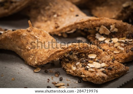 Freshly baked cookie snacks with healthy oats and chia seeds in twirl format.