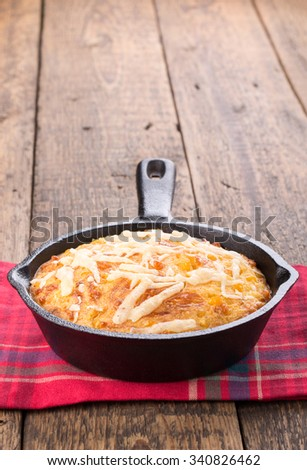 Freshly baked corn bread in cast iron pan. Copy space. - stock photo