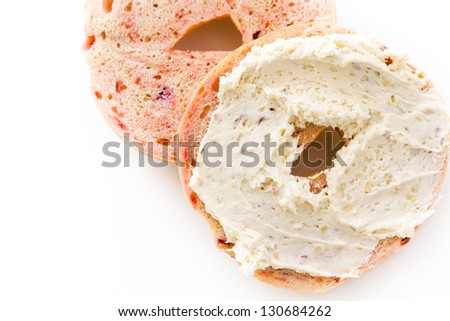 Freshly baked cranberry bagel. - stock photo