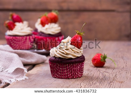 freshly baked cupcakes with strawberry - stock photo