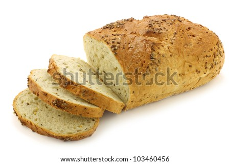freshly baked cut loaf of cornbread on a  white background - stock photo