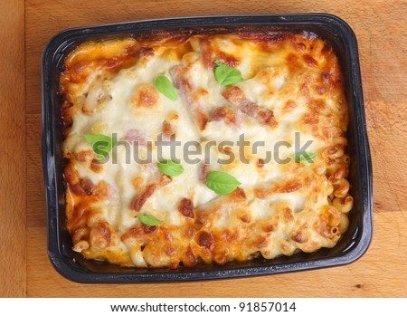 Freshly baked family-sized pasta ready meal with chicken, bacon and cheese. - stock photo