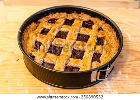 Freshly baked homemade Austrian Linzer Tarte with jam and almonds - stock photo