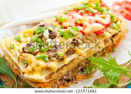 Freshly baked homemade vegetables lasagna. Traditional Italian cuisine - stock photo