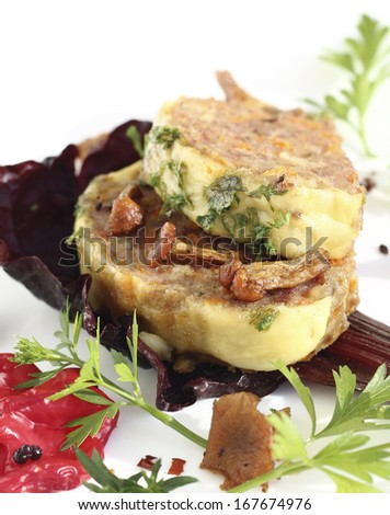 Freshly baked meatloaf with vegetables and mushrooms - stock photo