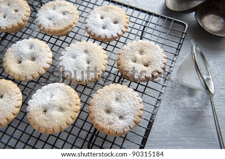 Freshly Baked Mince Pies, Having Been Sprinkled With Icing Sugar - stock photo