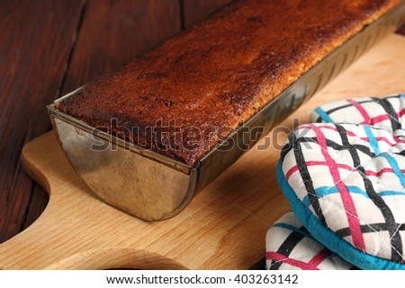 Freshly baked raisin butter cake in loaf tin