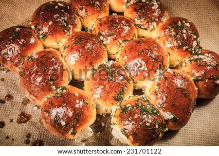 freshly baked rolls smeared garlic butter and dill. Tinted. - stock photo