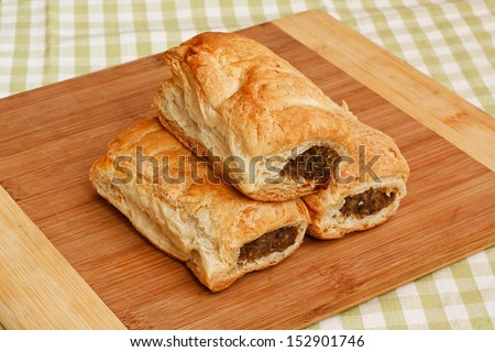 Freshly baked sausage rolls in a traditional setting a popular pastry snack available hot or cold from any English Bakery recently subject to the pasty tax for hot food - stock photo