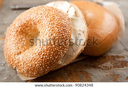 Freshly Baked Sesame Seed and Plain Bagels with Spread - stock photo