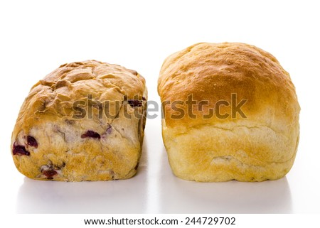 Freshly baked sourdough breads on a white background.