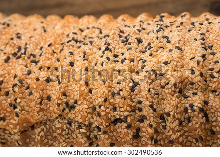 Freshly baked whole bread or roll with sesame seeds for healthy diet - stock photo