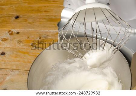 Freshly beaten stiff egg white inside a food processor - stock photo