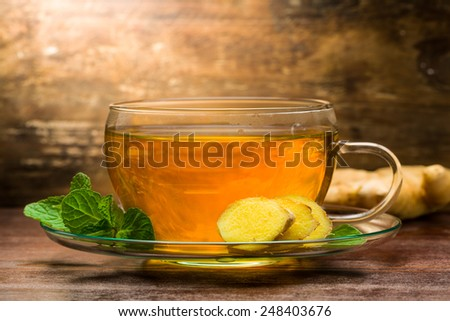 Freshly brewed ginger tea with mint - stock photo