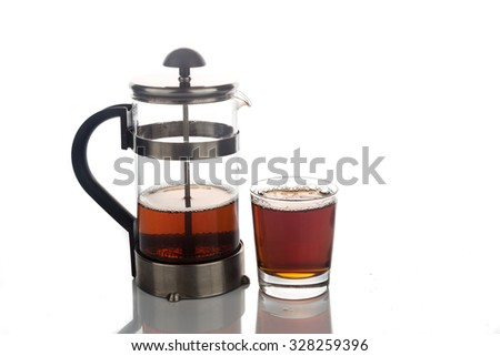 Freshly brewed hot tea in transparent glass with portafilter.