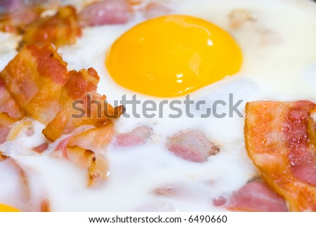 freshly cooked bacon and eggs - stock photo