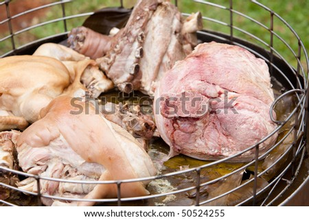 freshly cooked meats in steamer basket