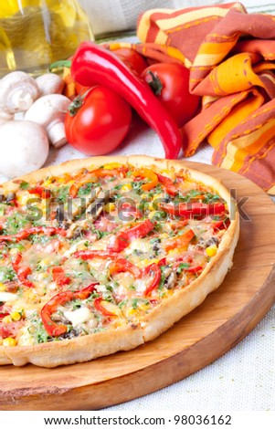 Freshly cooked pizza topped with cheese - stock photo