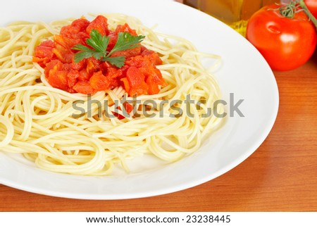 Freshly cooked plate of spaghetti with tomato sauce just for eating on wooden background. Shallow depth of field