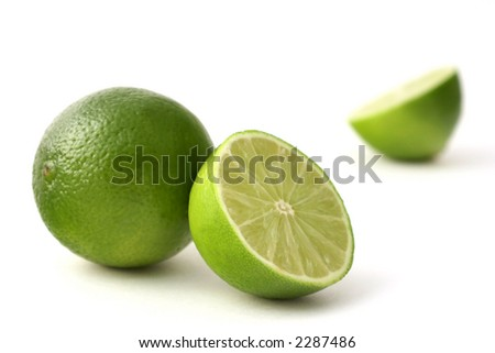 freshly cut limes on a white back ground - stock photo