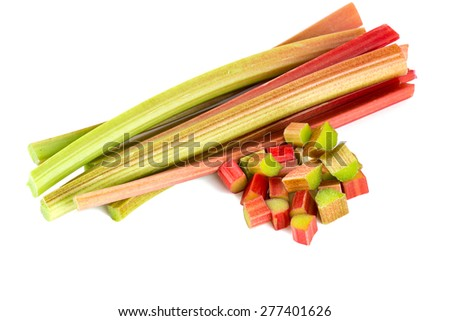 freshly cut stems of rhubarb on a white background - stock photo
