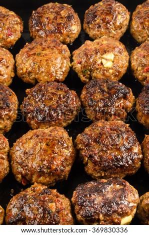 freshly fried organic pork meatballs with onions - stock photo