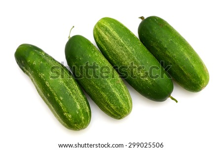 freshly green cucumbers on white background  - stock photo