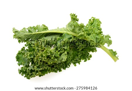 freshly green kale leaves isolated on white