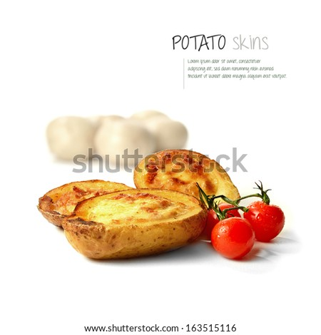 Freshly grilled bacon and cheddar cheese potato skins with dew covered cherry tomatoes against white. The perfect image for a bistro or restaurant menu design or an advertisement. Copy space. - stock photo