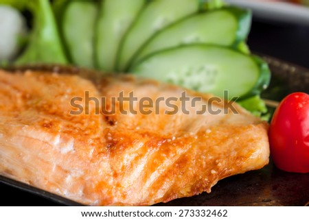 Freshly grilled salmon steak with green cucumber for a healthy cuisine - stock photo