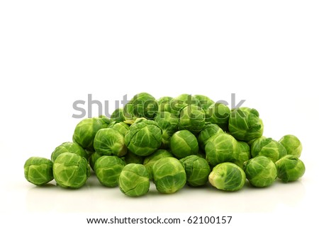 Freshly harvested Brussel sprouts  on a white background - stock photo