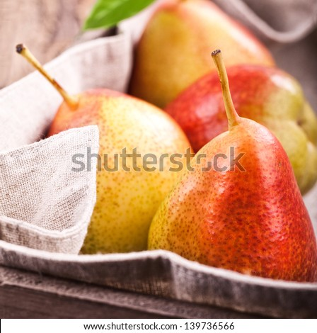Freshly harvested pears in old wooden crate