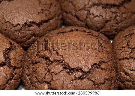 freshly made chocolate cookies on a tray food background