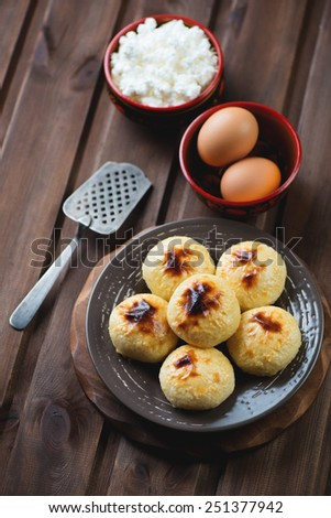 Freshly made cottage cheese pancakes and cooking ingredients - stock photo