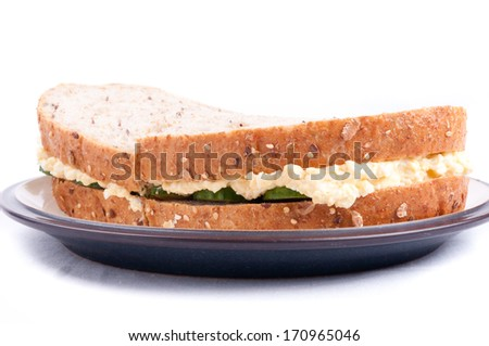 freshly made egg salad sandwiches on seed bread - stock photo