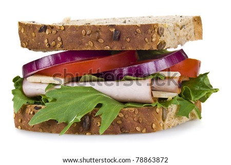 Freshly made ham and vegetable sandwich - isolated - stock photo