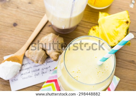 Freshly made pineapple ginger smoothie with Greek yogurt and juice. - stock photo