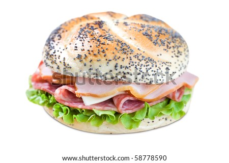 Freshly made sandwich on cutting board - stock photo