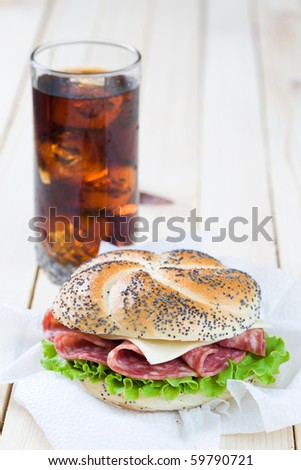 Freshly made sandwich with cold cut meat and lettuce - stock photo