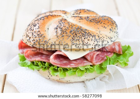 Freshly made sandwich with salami and cheese - stock photo