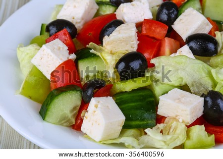 Freshly maked Greek salad with olive, cheese and vegetables - stock photo