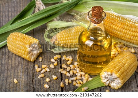 Freshly picked domestic corn with corn oil - stock photo